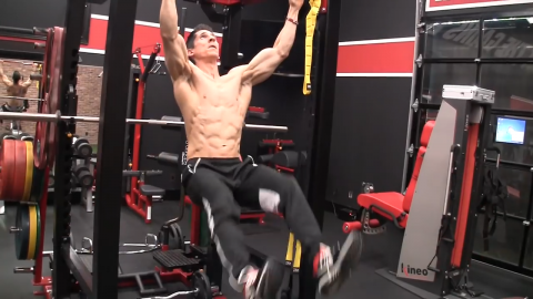 adduction of legs in hanging x raise abs exercise