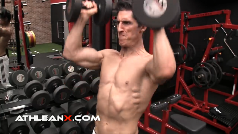 dumbbell standing overhead press for shoulder strength